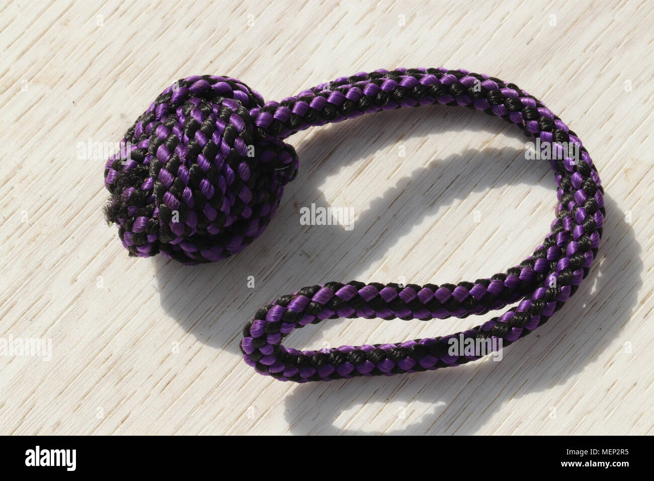 close up of knotted rope dog toy - Stock Image