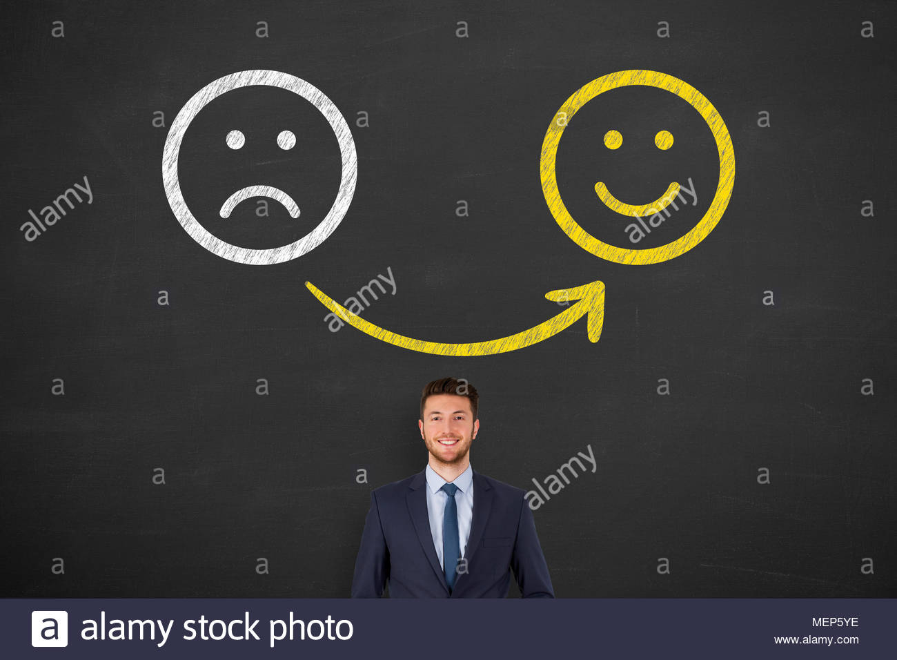 Unhappy and Happy Smiley on Blackboard Background - Stock Image