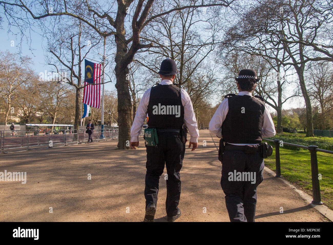A policeman and a policewoman on patrol on The Mall in central London Stock Photo