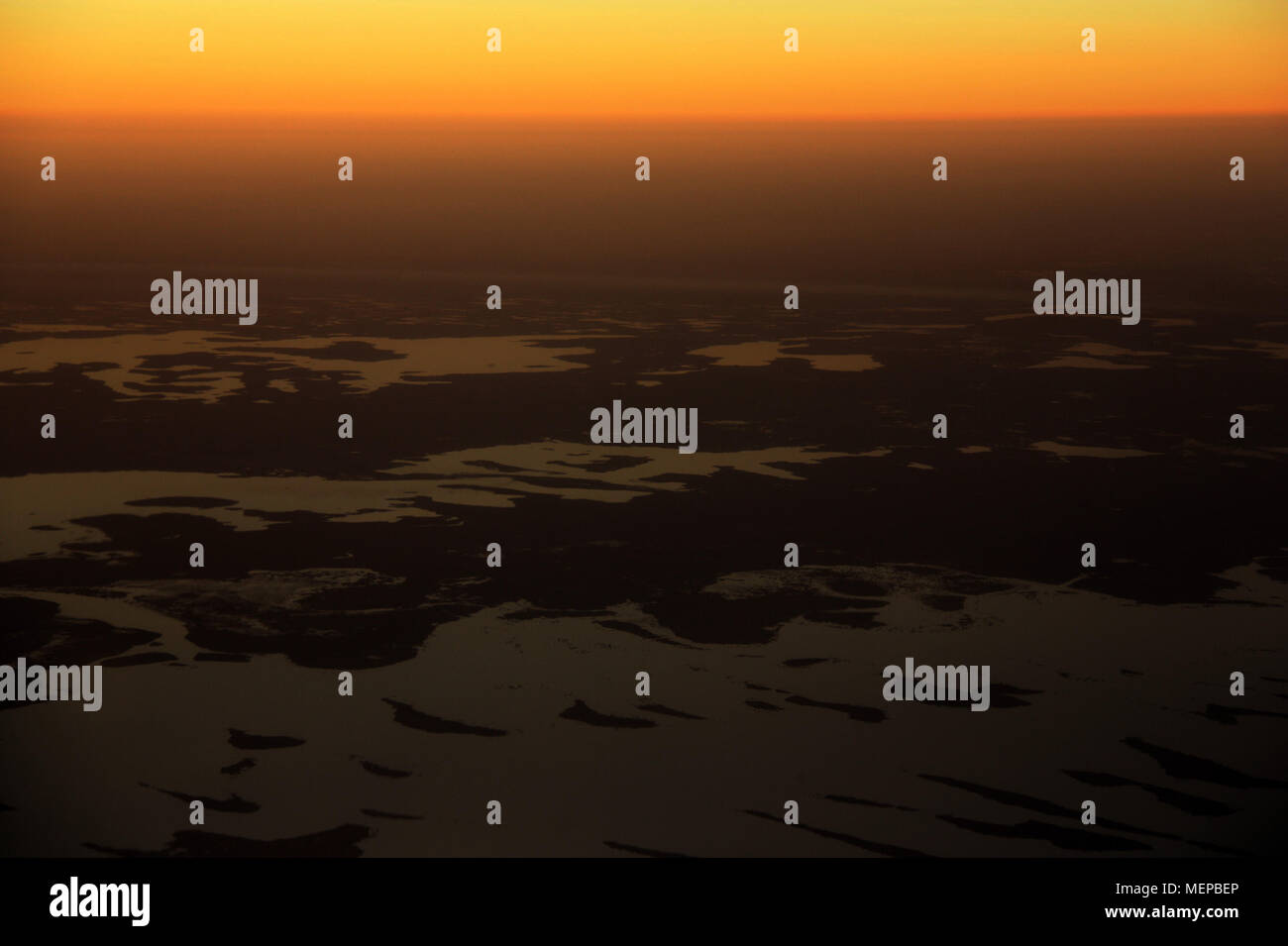 Lake Chad seen from the Airplane during a beautiful Sunset - Stock Image