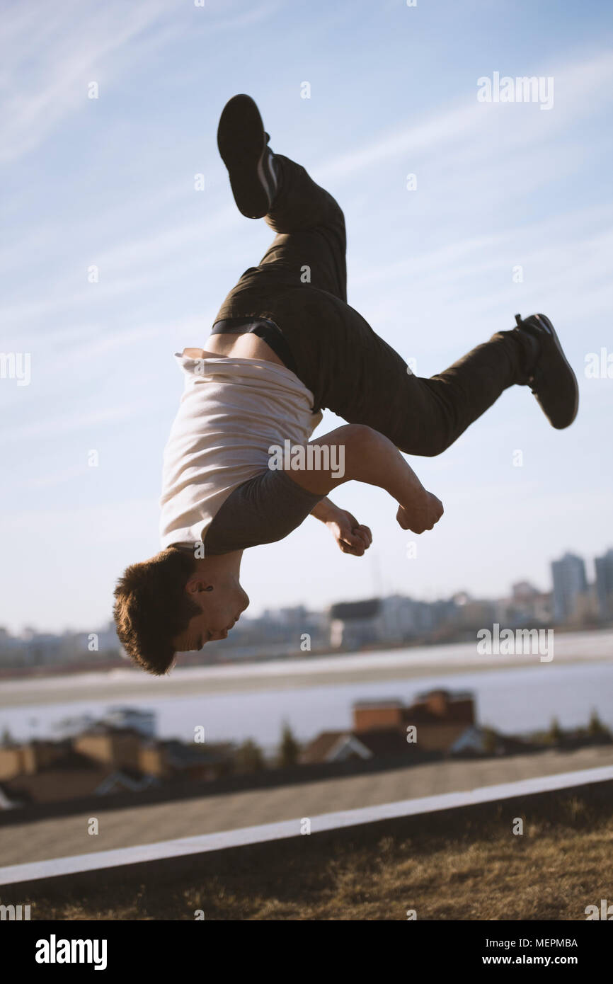 Young man jumping outdoor - sport parkour - Stock Image
