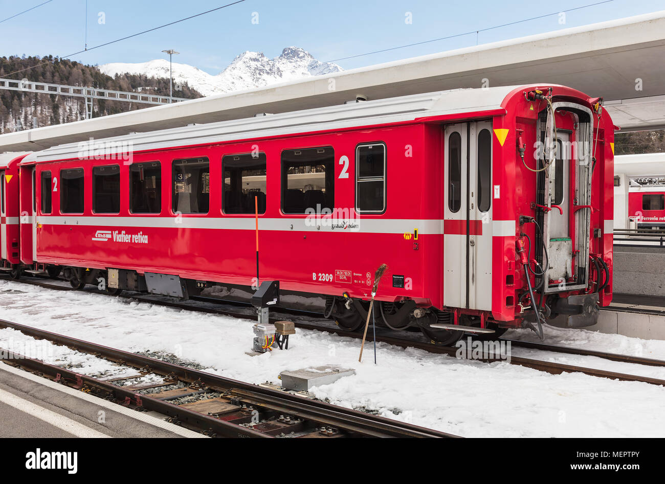 St. Moritz, Switzerland - 3 March, 2017: a railroad car of the Rhaetian Railway at a platform of the St. Moritz railway station. The Rhaetian Railway  - Stock Image