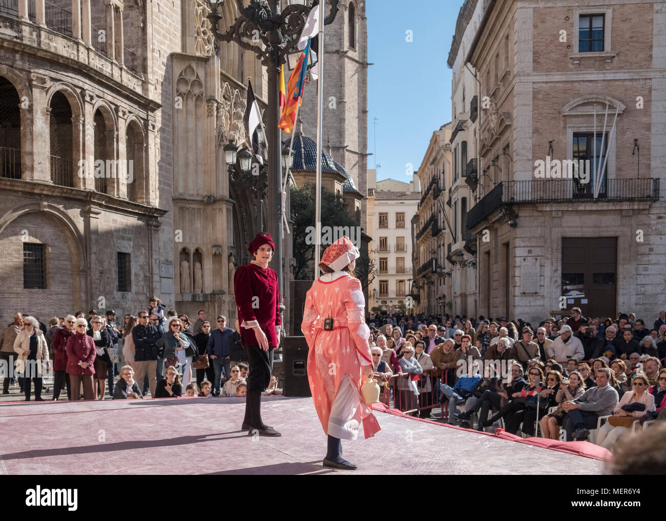 People watching a theatrical performance in Plaza de la Virgen, North Ciutat Vella district, the old town part of Valencia, Spain. Stock Photo