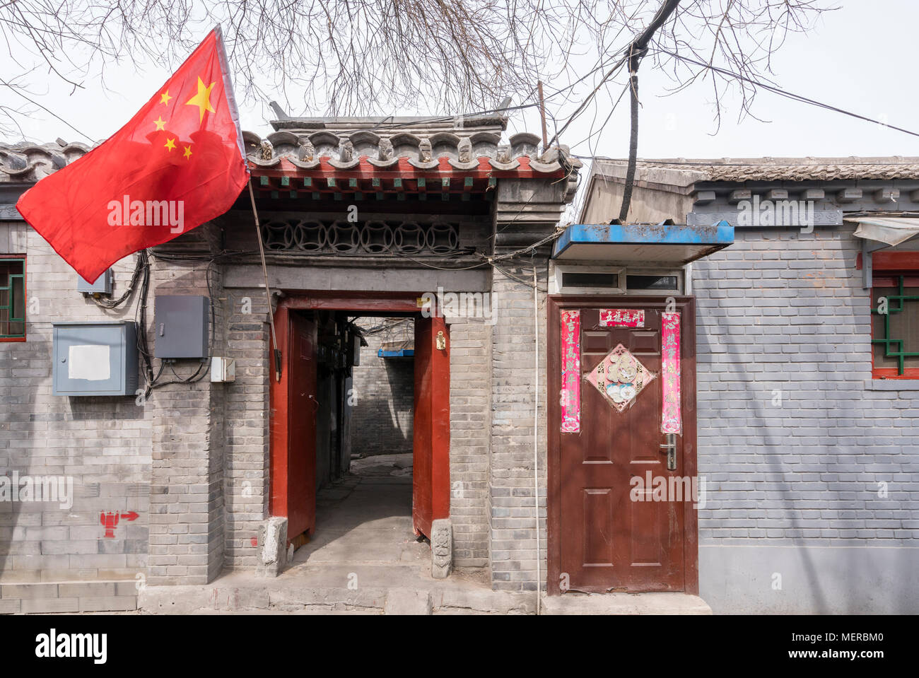Entrance to a house at a hutong in Beijing - Stock Image