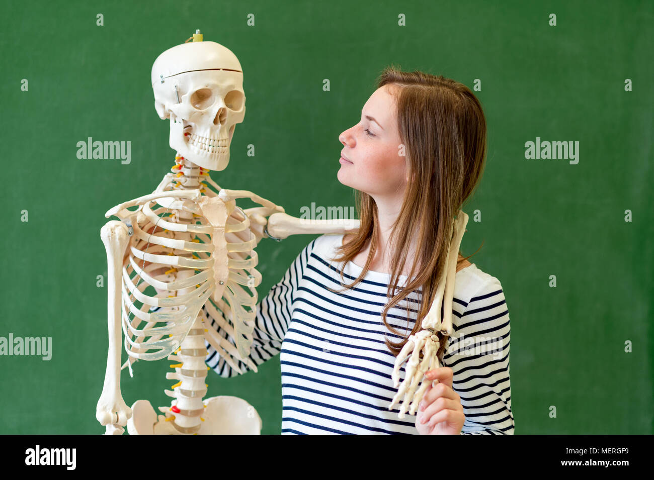 Cool female high school student portrait with an artificial human ...