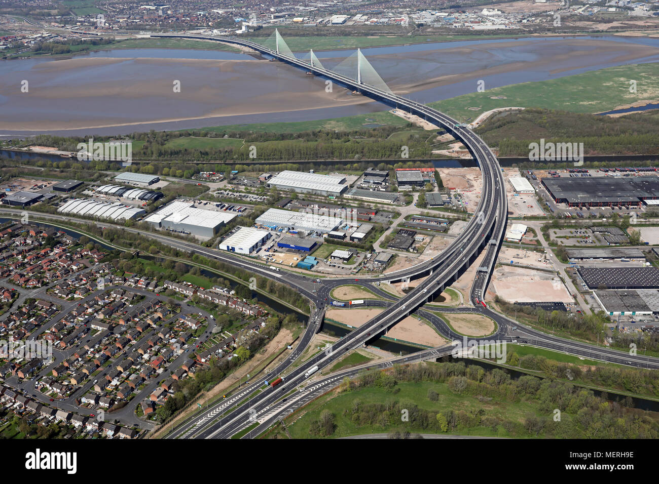aerial view of the A533 road at Runcorn as it crosses the new Mersey Gateway cablestay bridge - Stock Image