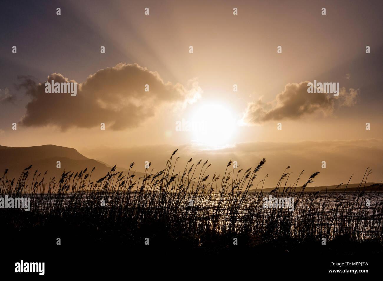 Sun goes down on Ireland's west coast 'Wild Atlantic Way' County Donegal Ireland - Stock Image