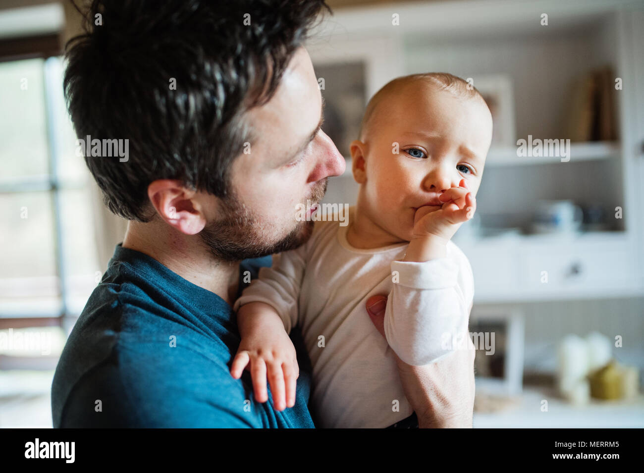 Father with a baby girl at home. - Stock Image