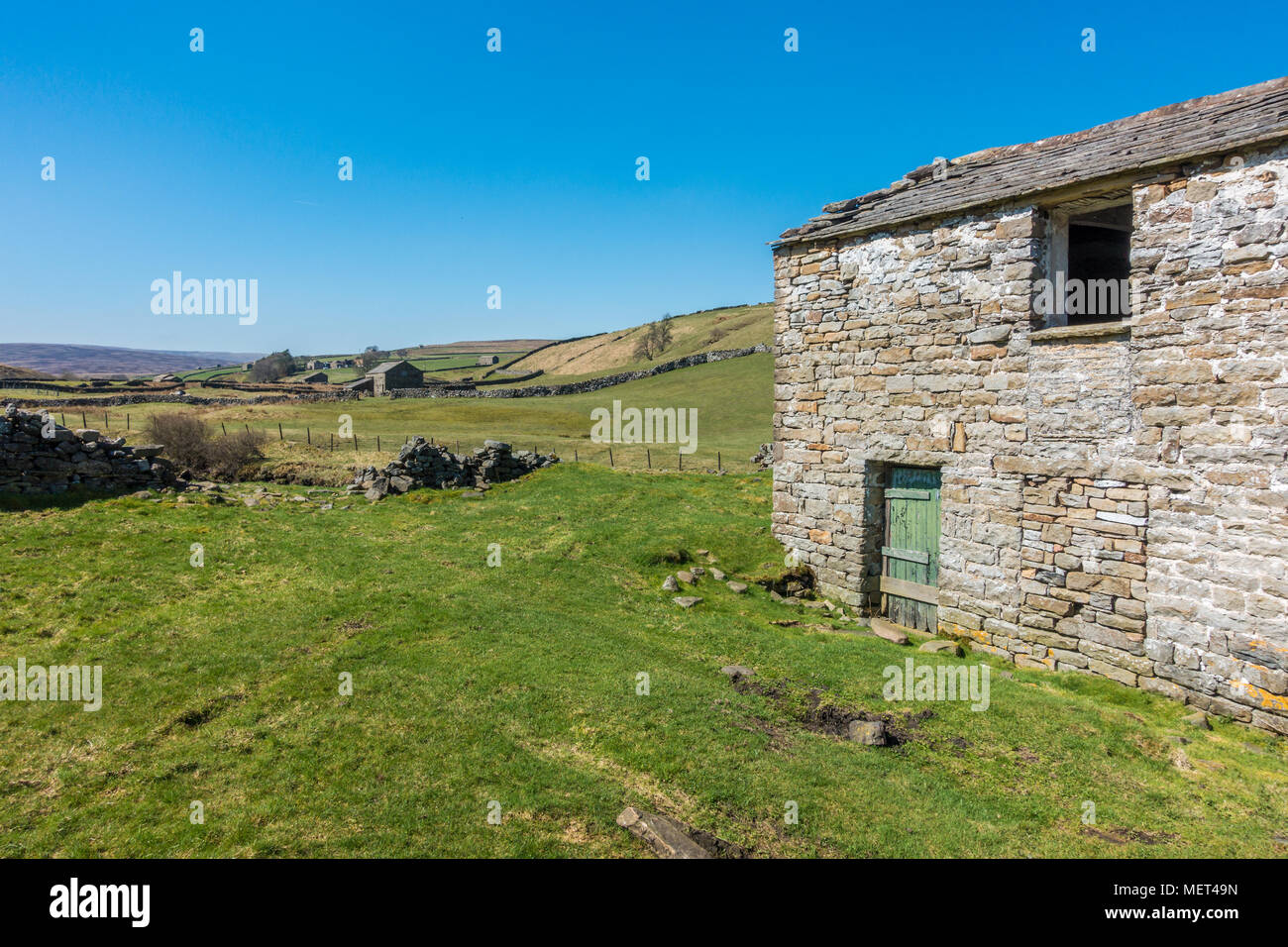 The beautiful old stone barns of Swaledale, Yorkshire Dales - Stock Image