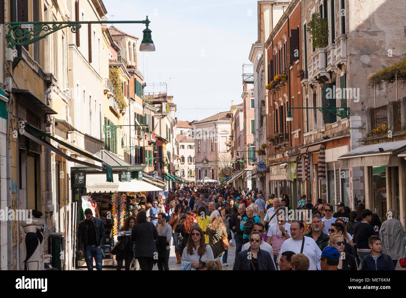 Crowd with hundreds of tourists Strada Nova, Cannaregio, Venice, Veneto, Italy in a low season period in early spring. Unsustainable tourism, overcrow - Stock Image