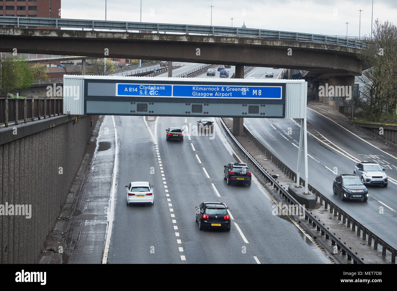 UK motorway signs on overhead gantry - junction 17 of the M8 Glasgow Scotland - Stock Image