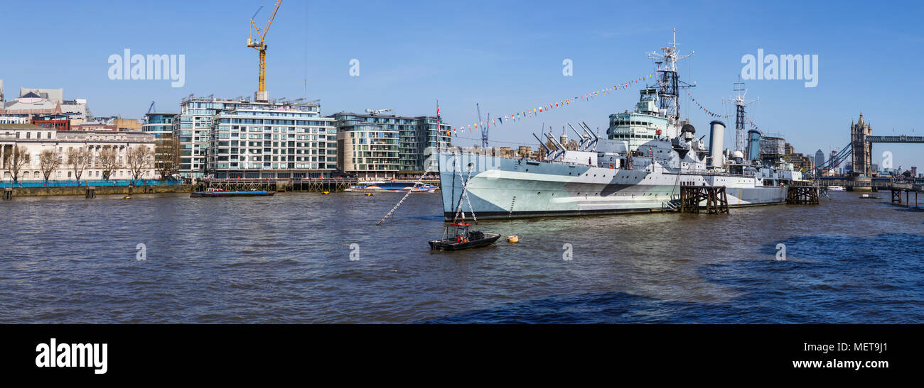 The iconic cruiser HMS Belfast moored on the River Thames in the Pool of London, now a leading tourist attraction and floating museum ship - Stock Image
