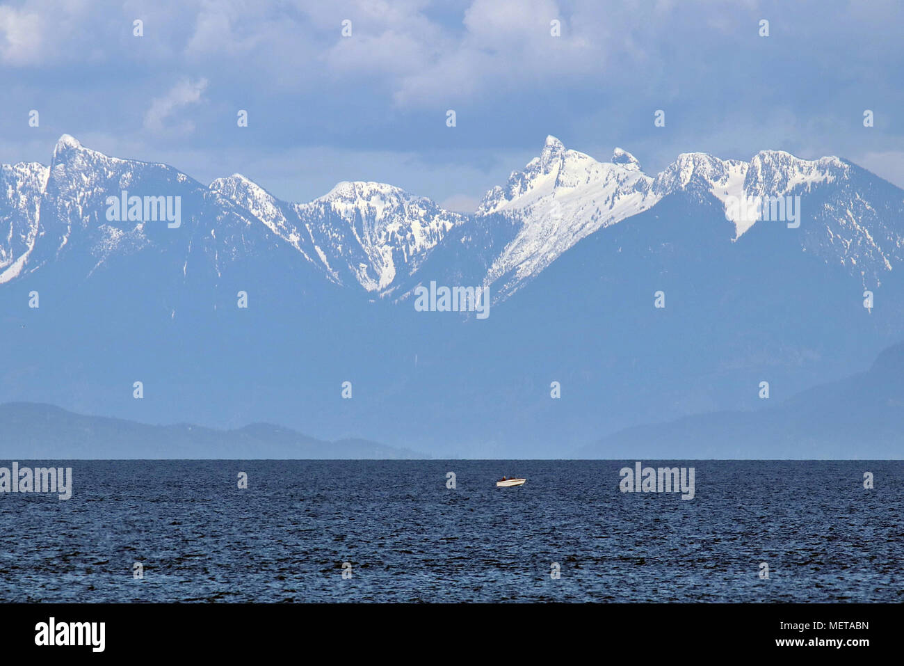 Mountains of Howe Sound across the Salish Sea from Nanaimo on Canada's Vancouver Island off the coast of British Columbia - Stock Image