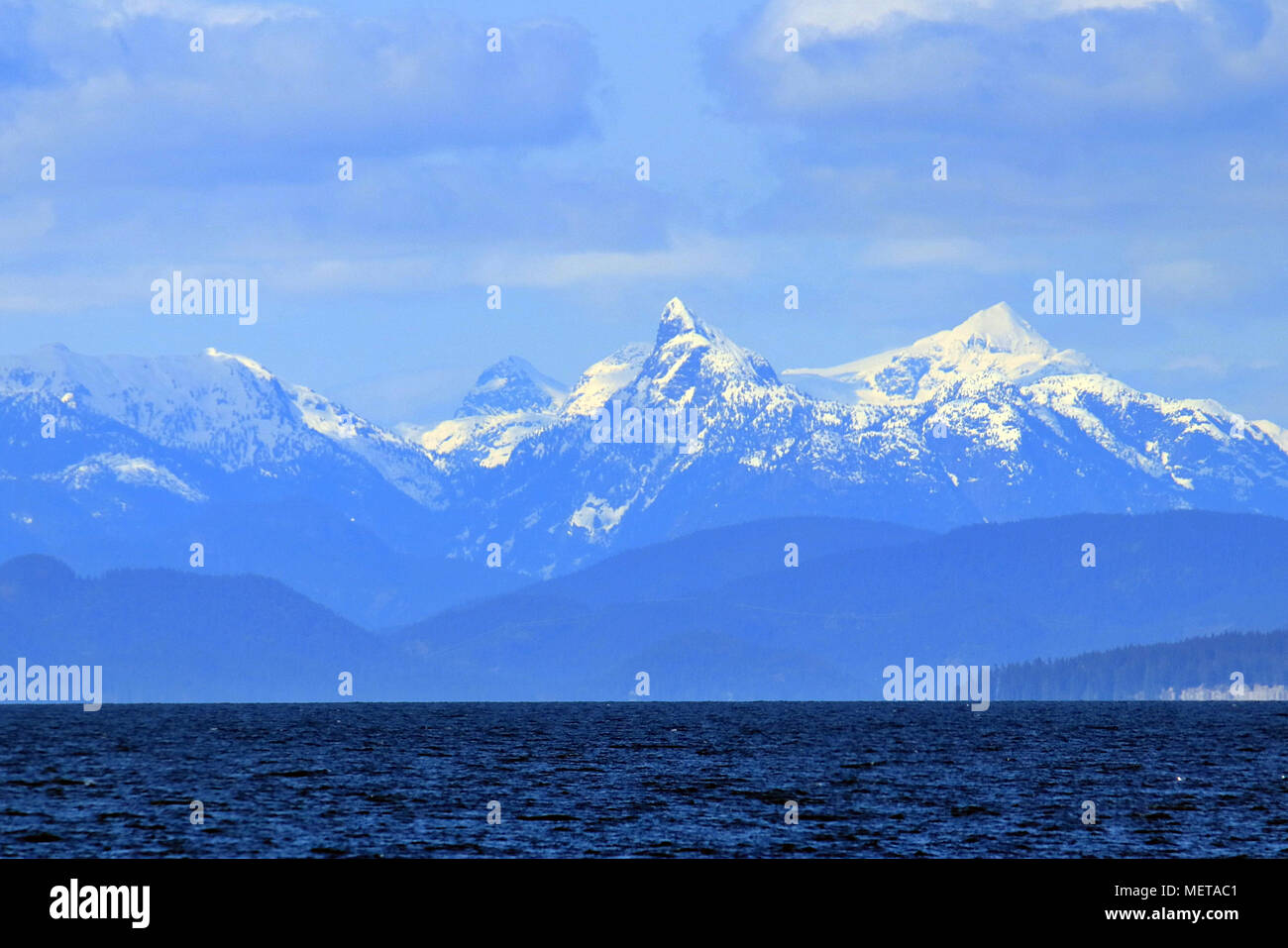Mountains of Jervis Inlet across the Salish Sea from Nanaimo on Canada's Vancouver Island off the coast of British Columbia - Stock Image
