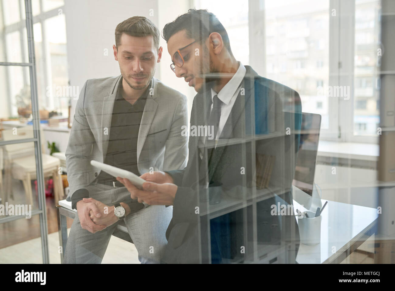 Colleagues Analyzing Statistic Data - Stock Image