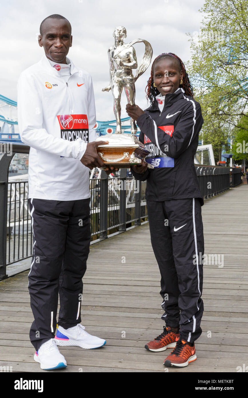 "London, 23rd April 2018. The elite women's race winner, Vivian Cheruiyot  (Kenya, 02:18:31), and the elite men's race winner, Eliud Kipchoge (Kenya, finish time 02:04:17) pose at the Virgin London Marathon 2018 champions photocall. Long-distance specialist Kipchoge has been described as ""the greatest marathoner of the modern era"", and also won the London Marathon in 2015 and 2016. Cheruiyot is a track and cross-country running specialist who made her London Marathon debut in 2017 Credit: Imageplotter News and Sports/Alamy Live News Stock Photo"