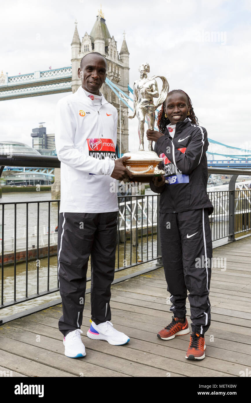 """London, 23rd April 2018. The elite women's race winner, Vivian Cheruiyot  (Kenya, 02:18:31), and the elite men's race winner, Eliud Kipchoge (Kenya, finish time 02:04:17) pose at the Virgin London Marathon 2018 champions photocall. Long-distance specialist Kipchoge has been described as """"the greatest marathoner of the modern era"""", and also won the London Marathon in 2015 and 2016. Cheruiyot is a track and cross-country running specialist who made her London Marathon debut in 2017 Credit: Imageplotter News and Sports/Alamy Live News Stock Photo"""