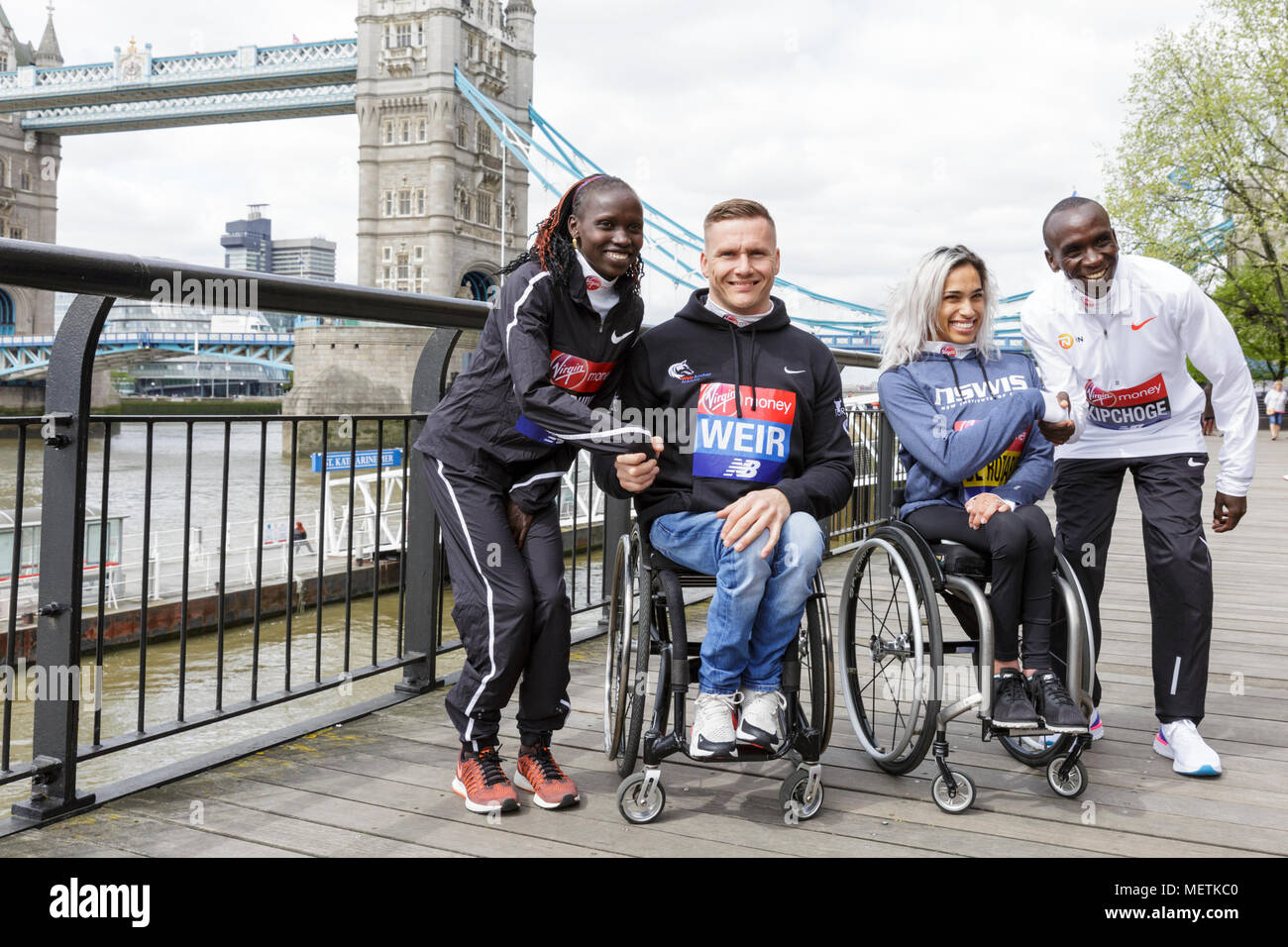 London, 23rd April 2018. The elite women's race winner, Vivian Cheruiyot  (Kenya), and the elite men's race winner, Eliud Kipchoge (Kenya) pose at the Virgin London Marathon 2018 champions photocall with Australian Madison de Rozario who won the women's wheelchair race, and Great Britain and Northern Ireland's David Weir, who won his eighth London Marathon men's wheelchair title. Credit: Imageplotter News and Sports/Alamy Live News Stock Photo