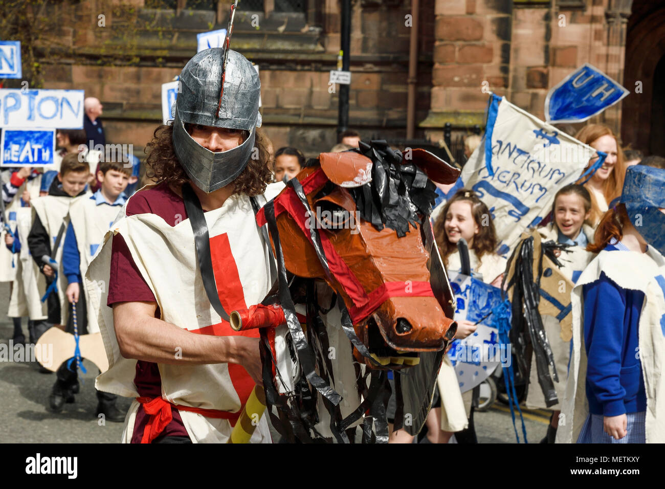 Chester, UK. 23rd April 2018. Phil Cross playing St George performs in the St George's Day parade through Chester city centre. The parade includes street performance, theatre and music with local school children performing many supporting roles. Credit: Andrew Paterson/Alamy Live News - Stock Image
