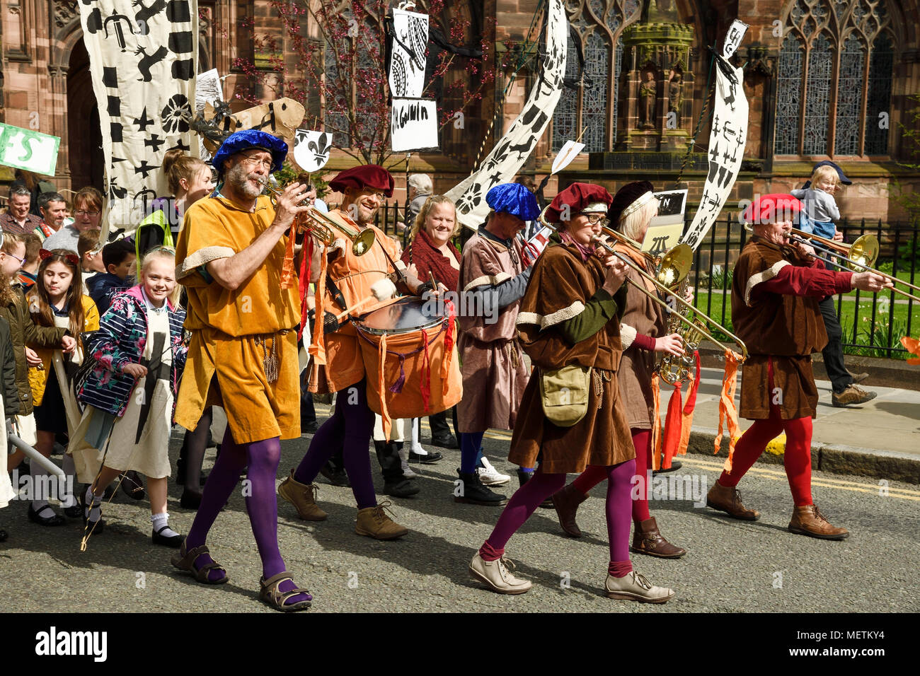 Chester, UK. 23rd April 2018. Musicians lead the St George's Day parade through Chester city centre. The parade includes street performance, theatre and music with local school children performing many supporting roles. Credit: Andrew Paterson/Alamy Live News - Stock Image