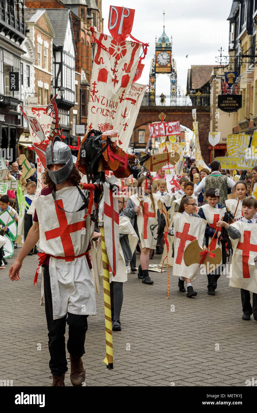 Chester, UK. 23rd April 2018. St George performs in the St George's Day parade through Chester city centre. The parade includes street performance, theatre and music with local school children performing many supporting roles. Credit: Andrew Paterson/Alamy Live News - Stock Image