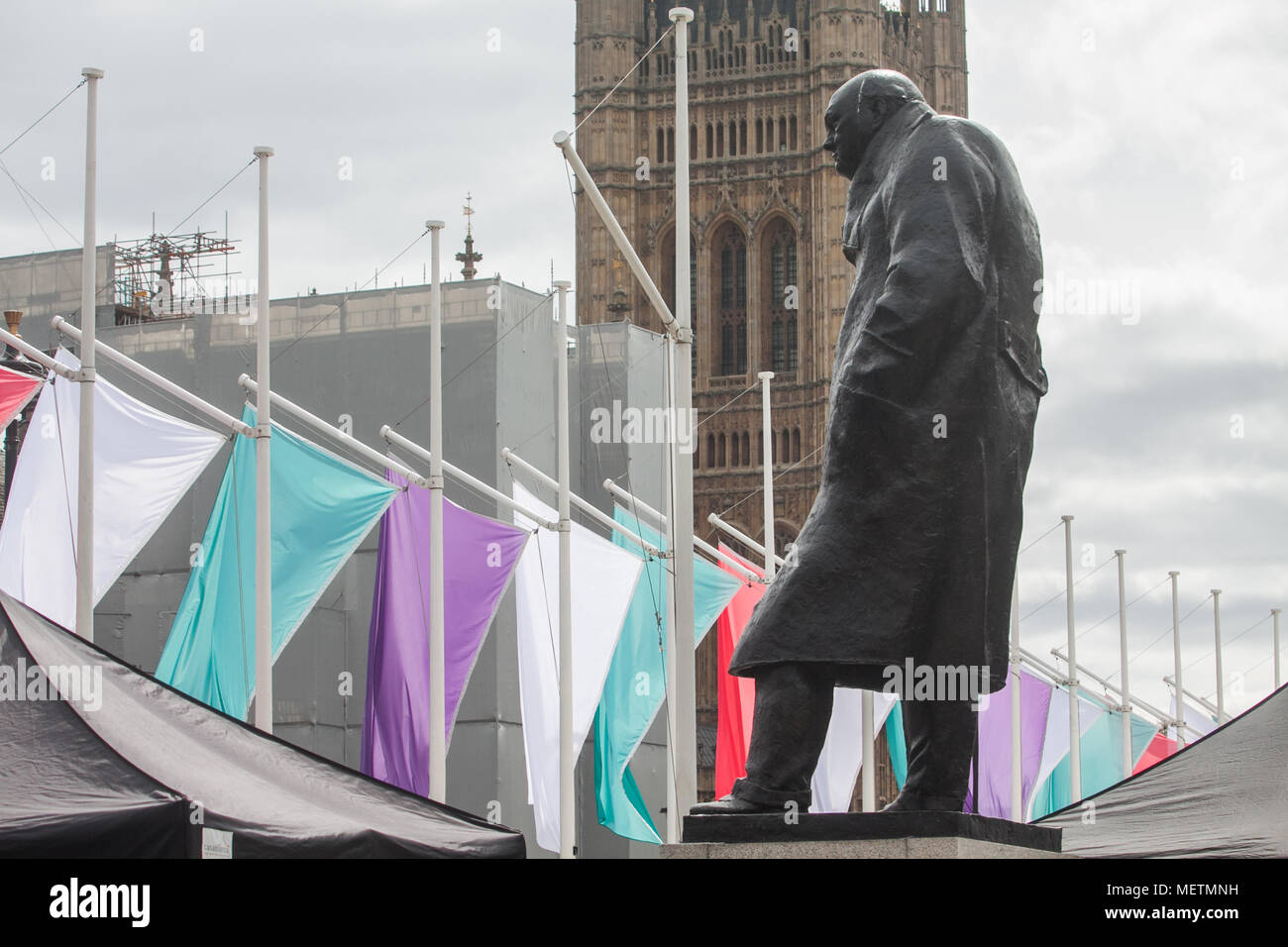 London UK. 23rd April 2018. Coloured Flags representing   the Sufragette movement hang in Parliament Square in honour of Millicent Fawcett ,a  British feminist, political and union leader, who  campaigned for women to have the vote. In 1908  Emmeline Pethick-Lawrence, designed the suffragettes' colour scheme of purple for loyalty and dignity, white for purity, and green for hope Credit: amer ghazzal/Alamy Live News Stock Photo