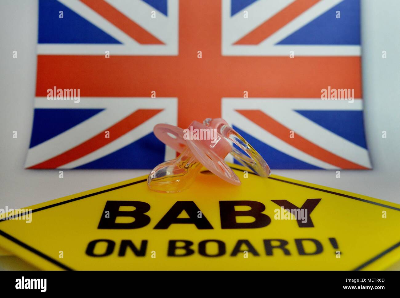 Osterode, Germany. 25th Jan, 2013. A soother is laying in front of the Union Jack. Credit: Frank May | usage worldwide/dpa/Alamy Live News - Stock Image
