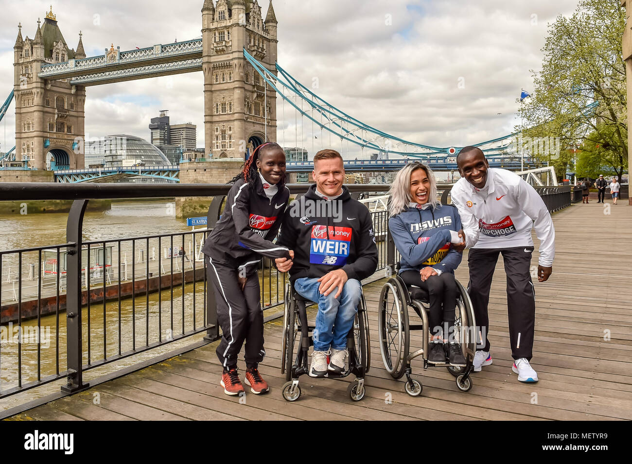 London, UK. 23rd April, 2018. Eliud Kipchoge (KEN), David Weir (GBR), Vivian Cheruiyot (KEN) and Madison de Rozario (AUS) at Winners presentation after the 2018 Virgin Money London Marathon on Monday, 23 April 2018. London, England. Credit: Taka Wu/Alamy Live News - Stock Image