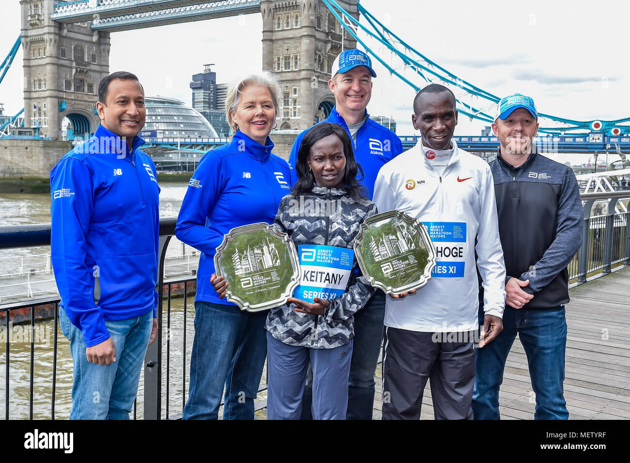 London, UK. 23rd April, 2018. Kenyan Eliud Kipchoge and Mary Keitany together the race officials at Winners presentation after the 2018 Virgin Money London Marathon on Monday, 23 April 2018. London, England. Credit: Taka Wu/Alamy Live News Stock Photo