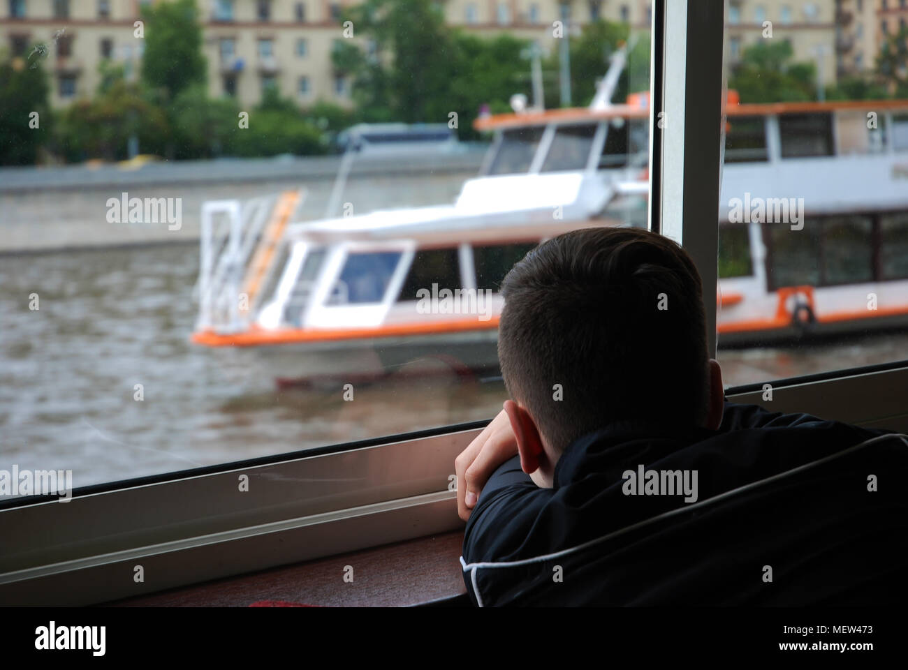 Boy looking at the Moscow river - Stock Image