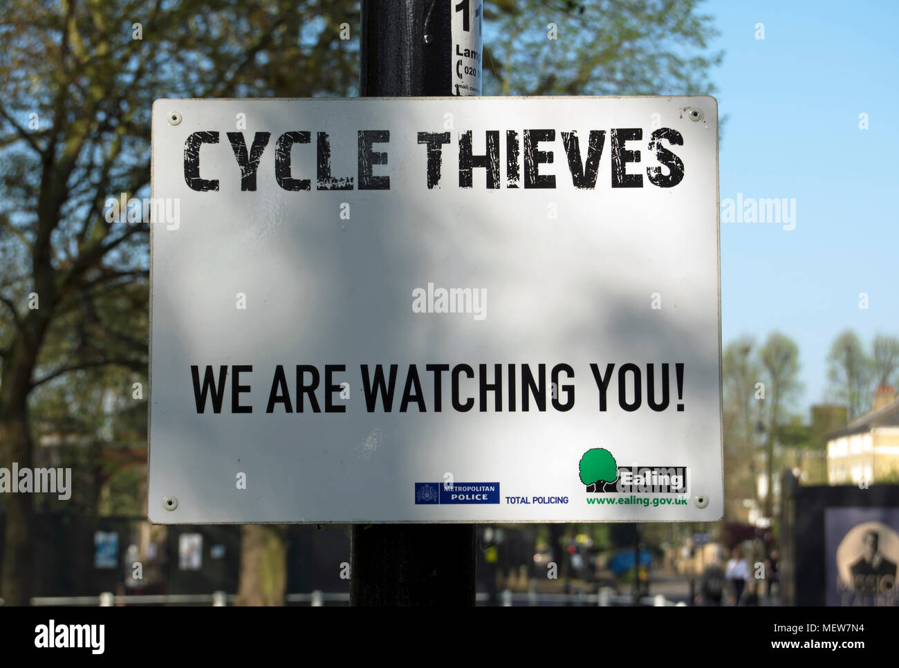 metropolitan police sign warning cycle thieves that they are being watched, ealing, west london, england - Stock Image