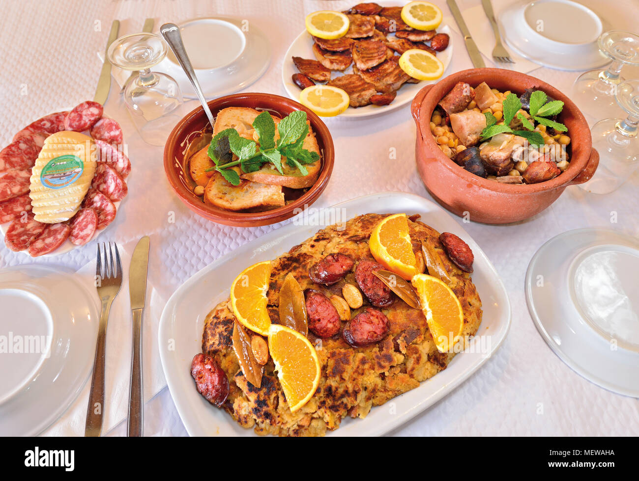 Restaurant table  with different dishes and regional countryside gastronomy - Stock Image