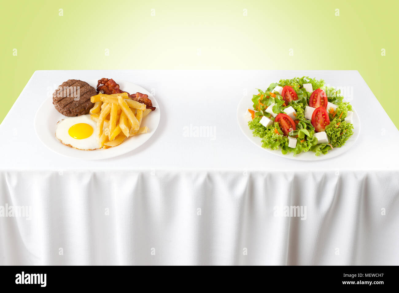 Contrasting healthy versus junk food - Stock Image
