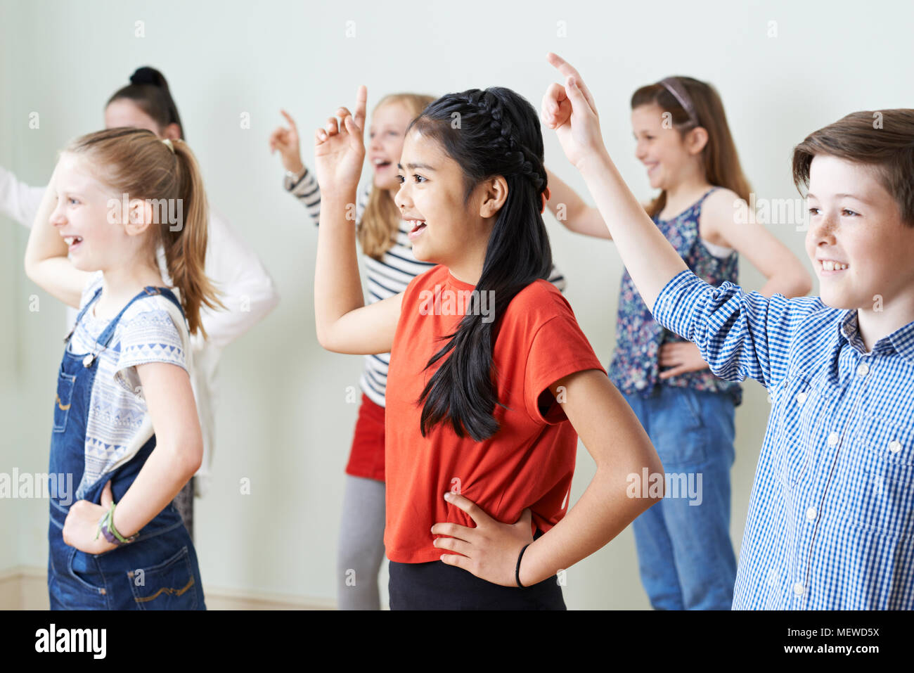 Group Of Children Dancing In Drama Class Together - Stock Image