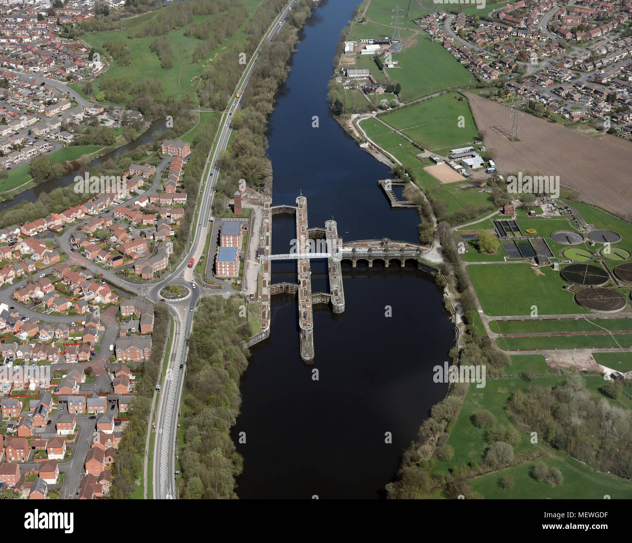 aerial view looking east up The Manchester Ship Canal at Irlam near Manchester, UK - Stock Image
