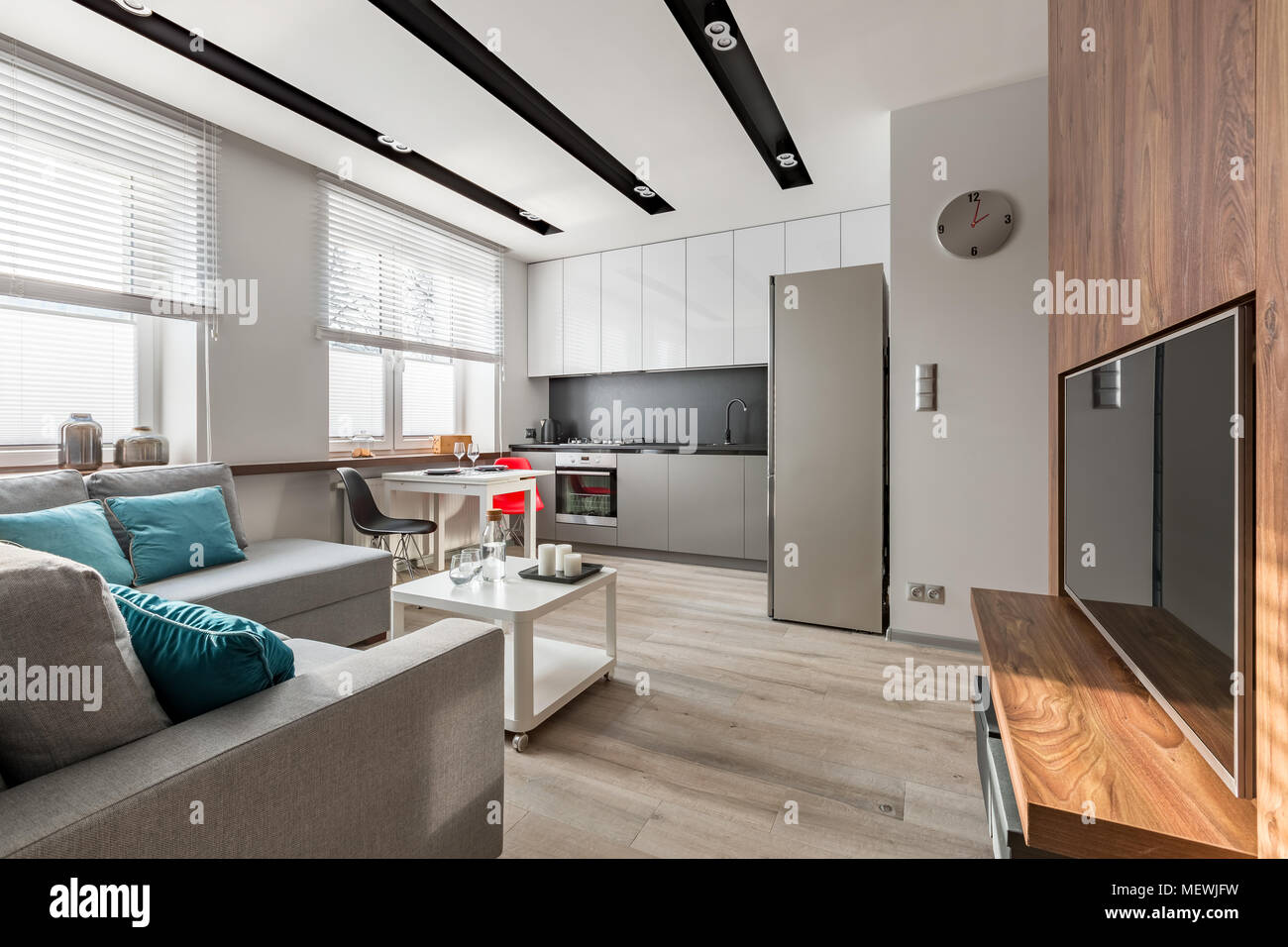 Contemporary Home Interior With Tv Living Room And Open Kitchen Stock Photo Alamy