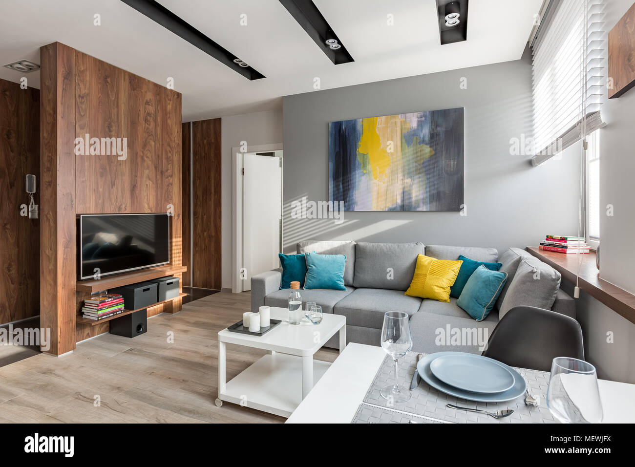 Tv Living Room With Wooden Wall Sofa And Dining Table Stock Photo Alamy