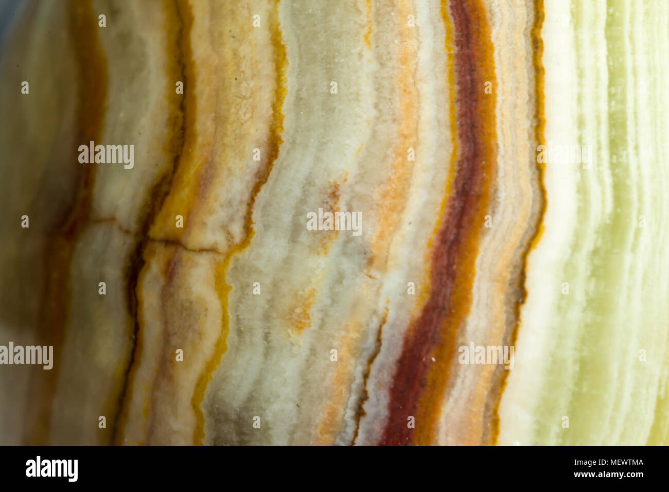 Macro photo texture of polished onyx stone. Photo for the site about geology, stones, jewelry, handwork, textures, art. - Stock Image