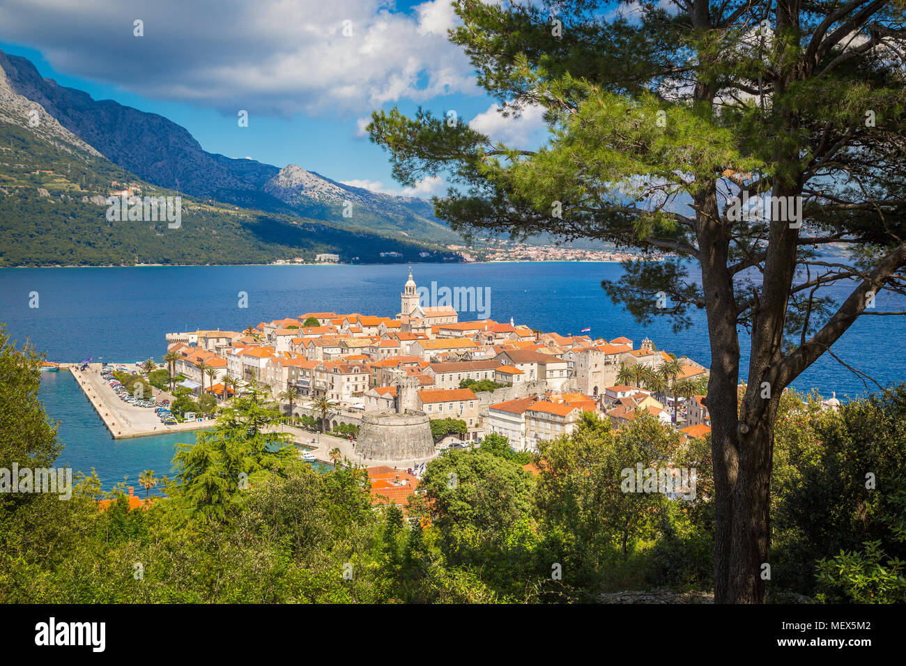 Beautiful view of the historic town of Korcula on a beautiful sunny day with blue sky and clouds in summer, Island of Korcula, Dalmatia, Croatia - Stock Image