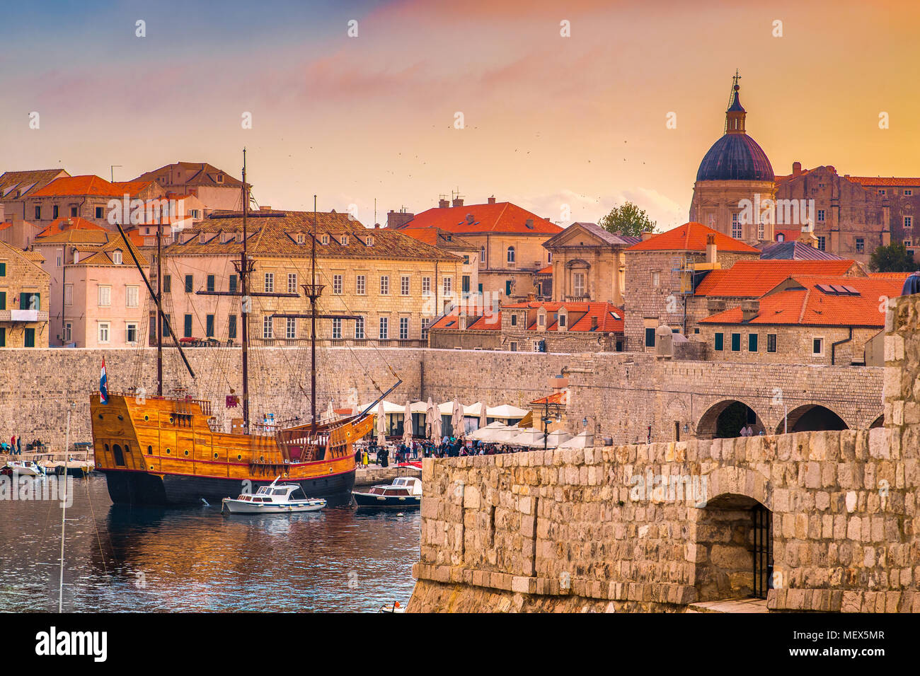 Panoramic aerial view of the historic town of Dubrovnik, one of the most famous tourist destinations in the Mediterranean Sea, at sunset, Croatia - Stock Image