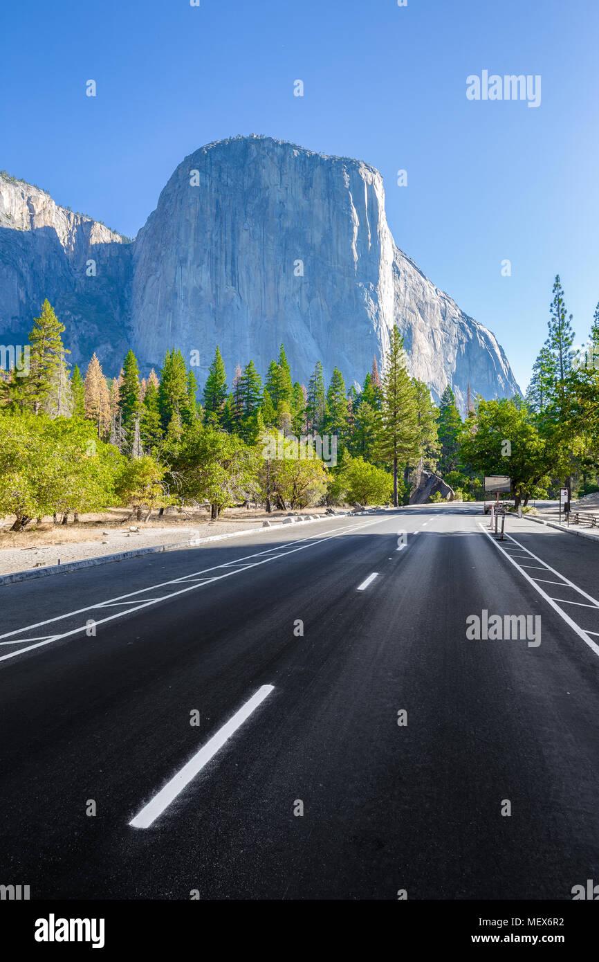 Famous El Capitan mountain peak with road running through Yosemite Valley in beautiful morning light at sunrise in summer, Yosemite National Park, USA Stock Photo