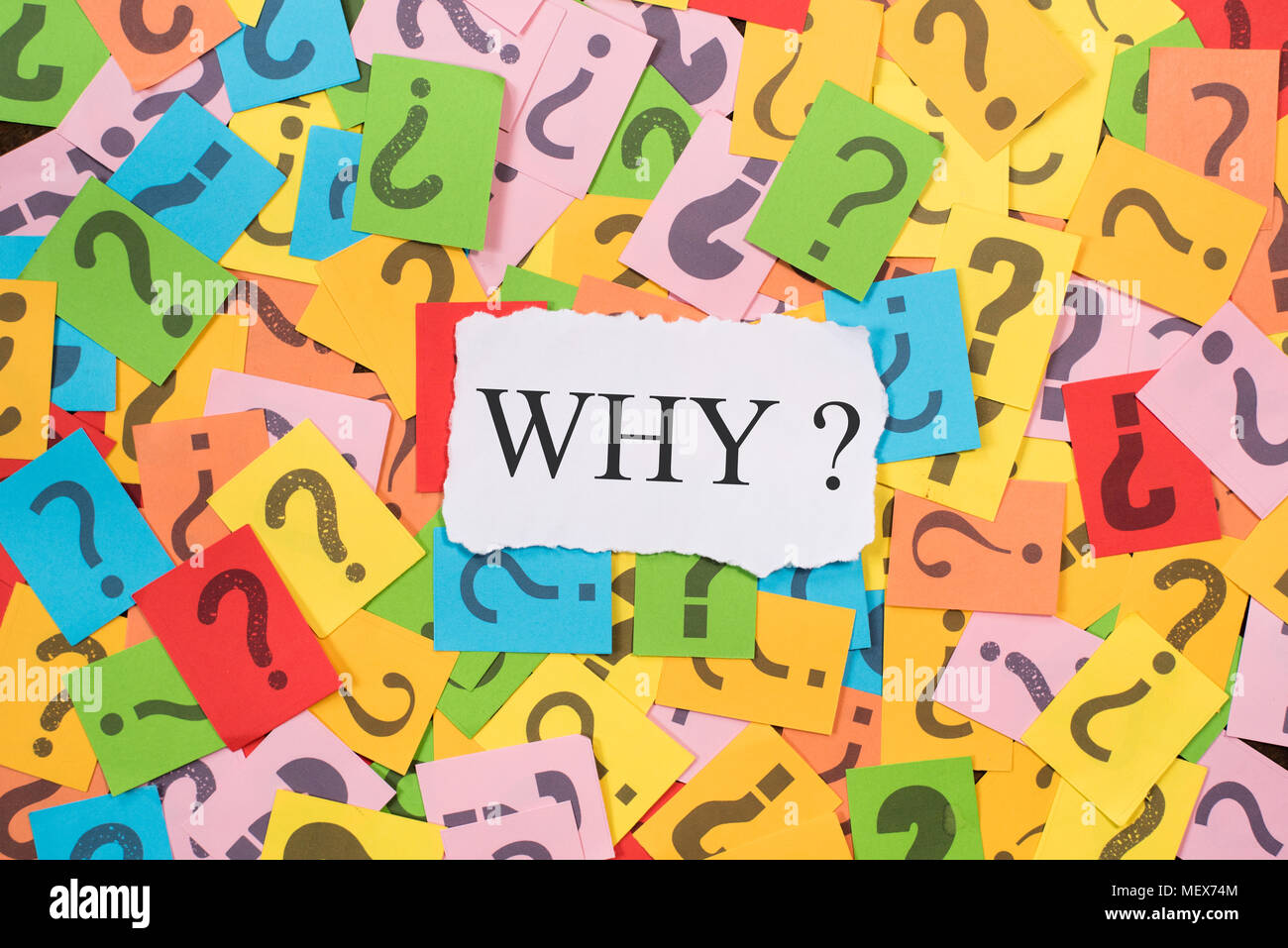 colourful paper note with question mark and white paper with word WHY. why concept background - Stock Image