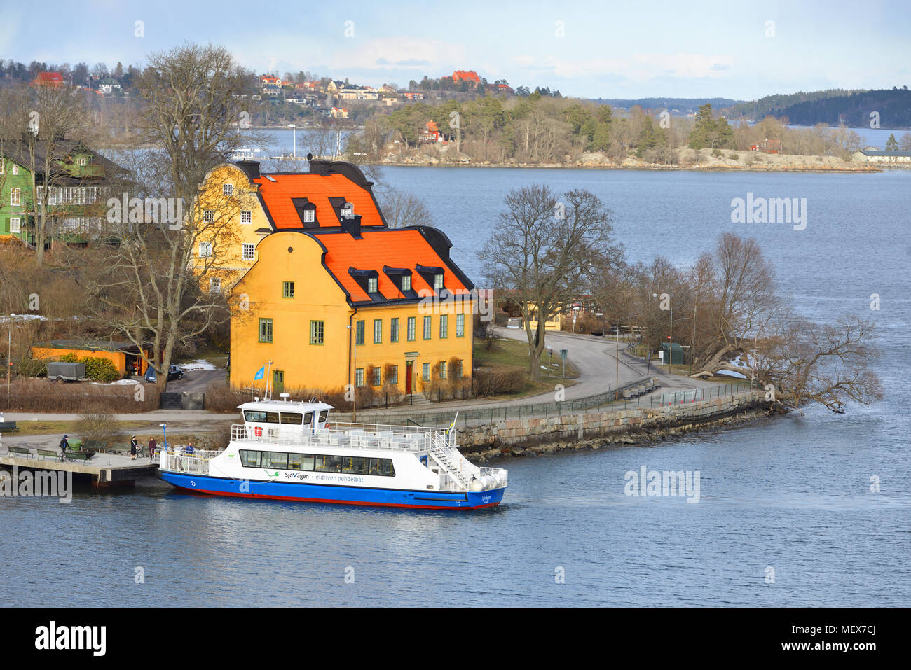 Stockholm archipelago. Ship in harbor of small island - Stock Image