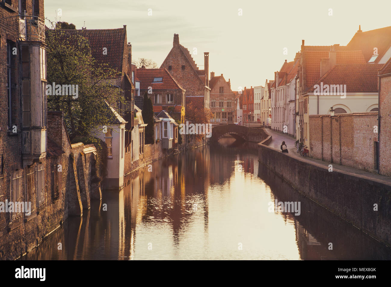 Classic view of the historic city center of Brugge, often referred to as The Venice of the North, in beautiful golden morning light at sunrise - Stock Image