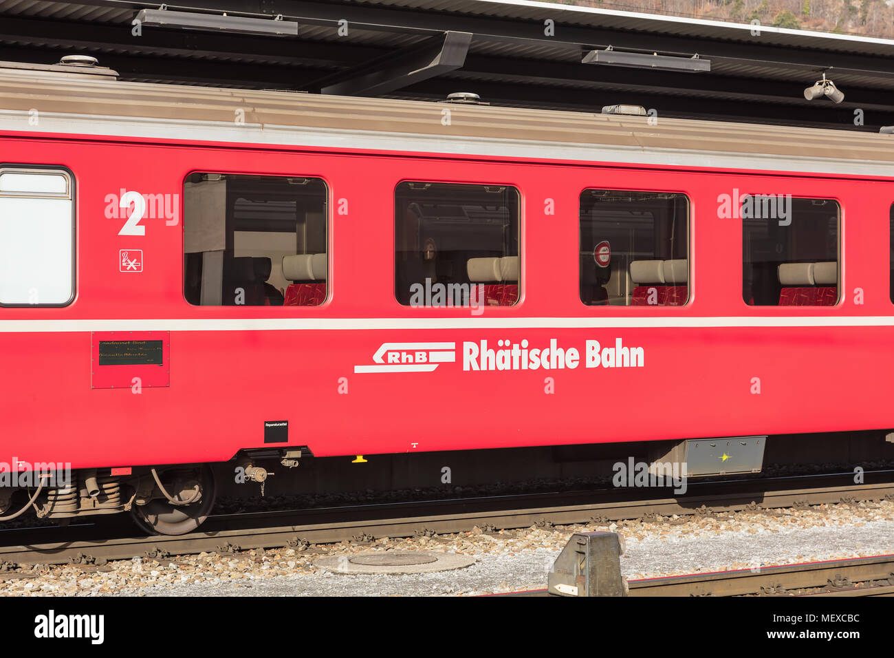 Landquart, Switzerland - 3 March, 2017: a railroad car of the Rhaetian Railway at a platform of the Landquart railway station. The Rhaetian Railway is - Stock Image