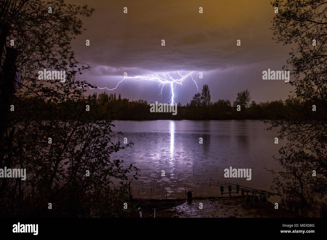 Lightning bolt as summer storm passes over carp fishing lake, Marlow, England, United Kingdom Stock Photo