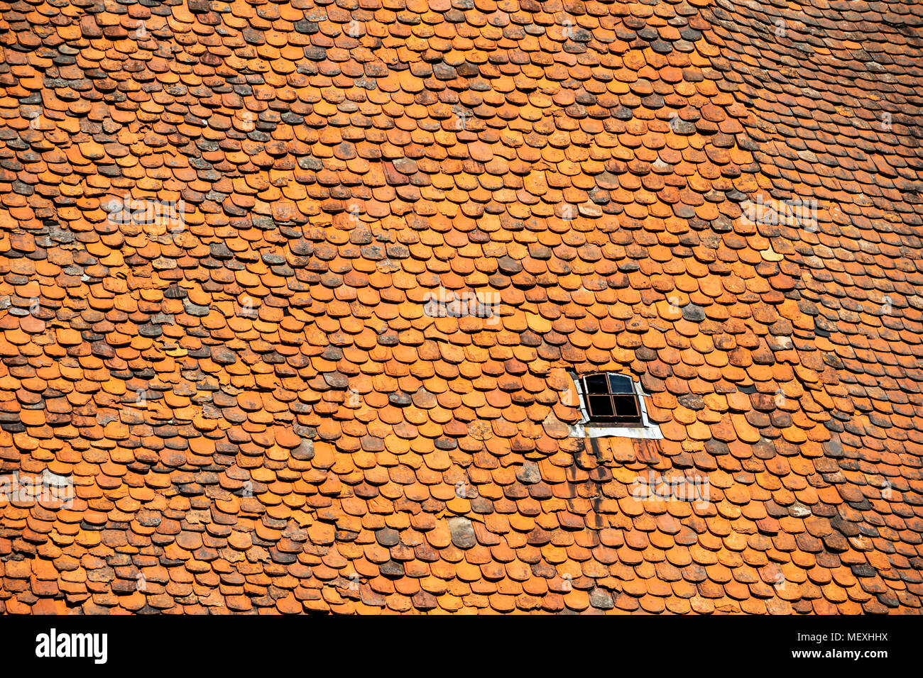 housetop with historic beaver-tail roofing tiles in Büdingen, Hesse, Germany, Europe Stock Photo