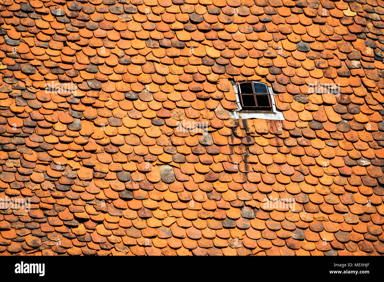 housetop with historic beaver-tail roofing tiles in Büdingen, Hesse, Germany, Europe - Stock Image