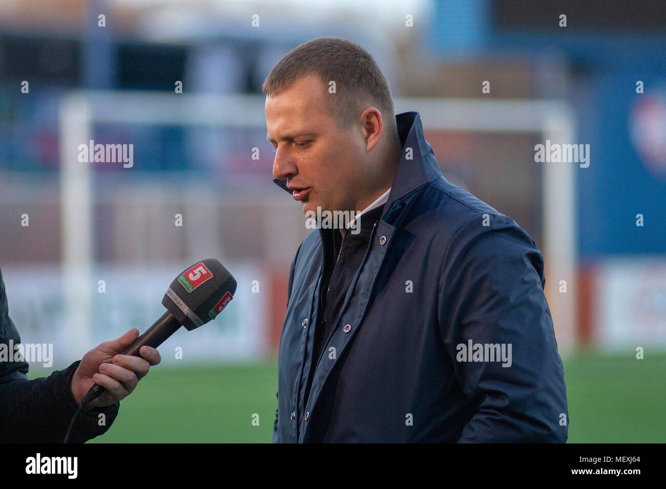 MINSK, BELARUS - APRIL 7, 2018: Vitaly Zhukovsky, head coach of FC Isloch gives interview after the Belarusian Premier League football match between FC Dynamo and FC Isloch at the FC Minsk Stadium. - Stock Image