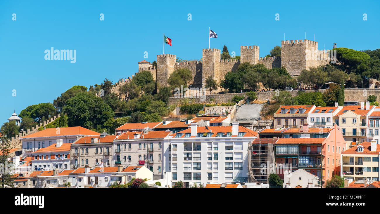 Panorama of Alfama with Saint George Castle on the hilltop. Lisbon. Portugal - Stock Image